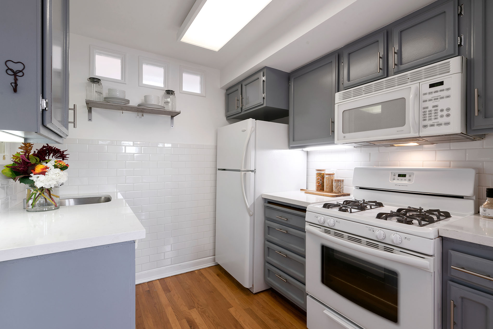 Kitchen - gray cabinets and white countertops in San Francisco