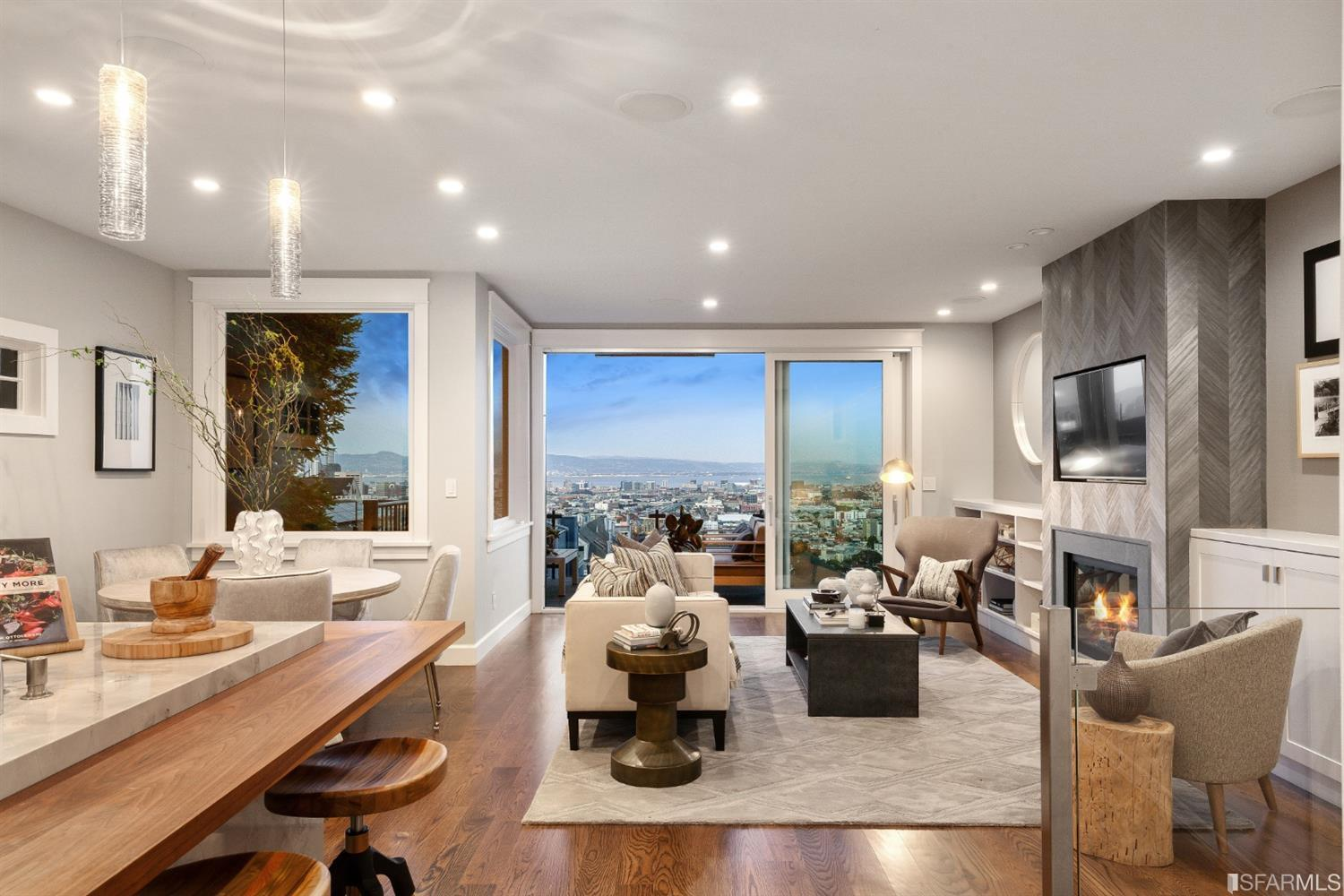 Gray and White living room overlooking the city at night