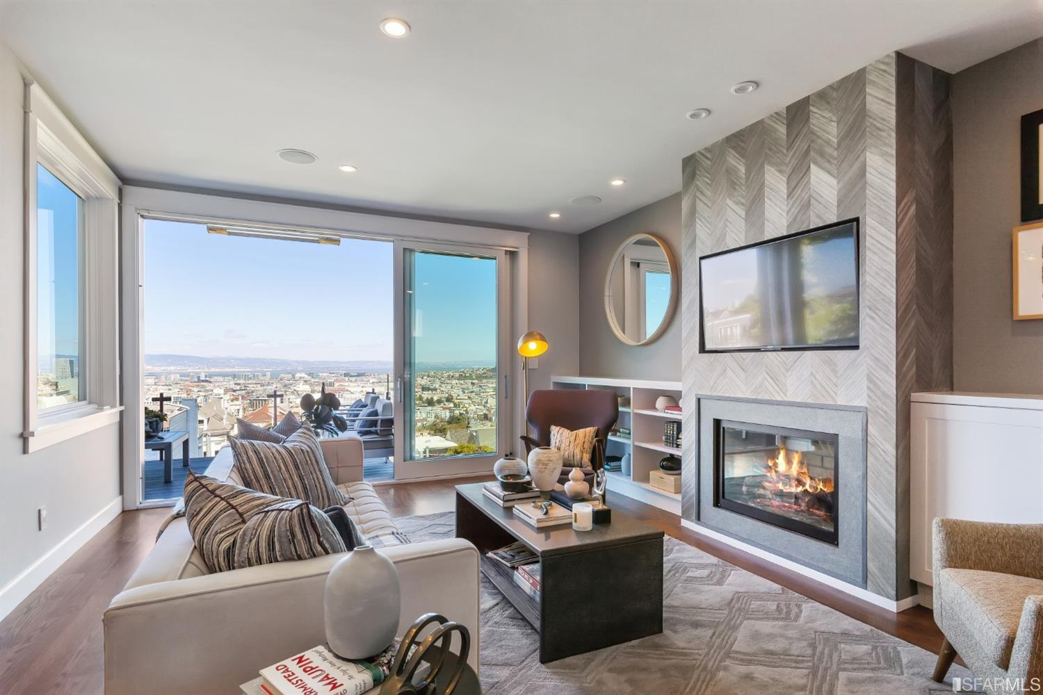 Gray and White living room overlooking the city during daytime