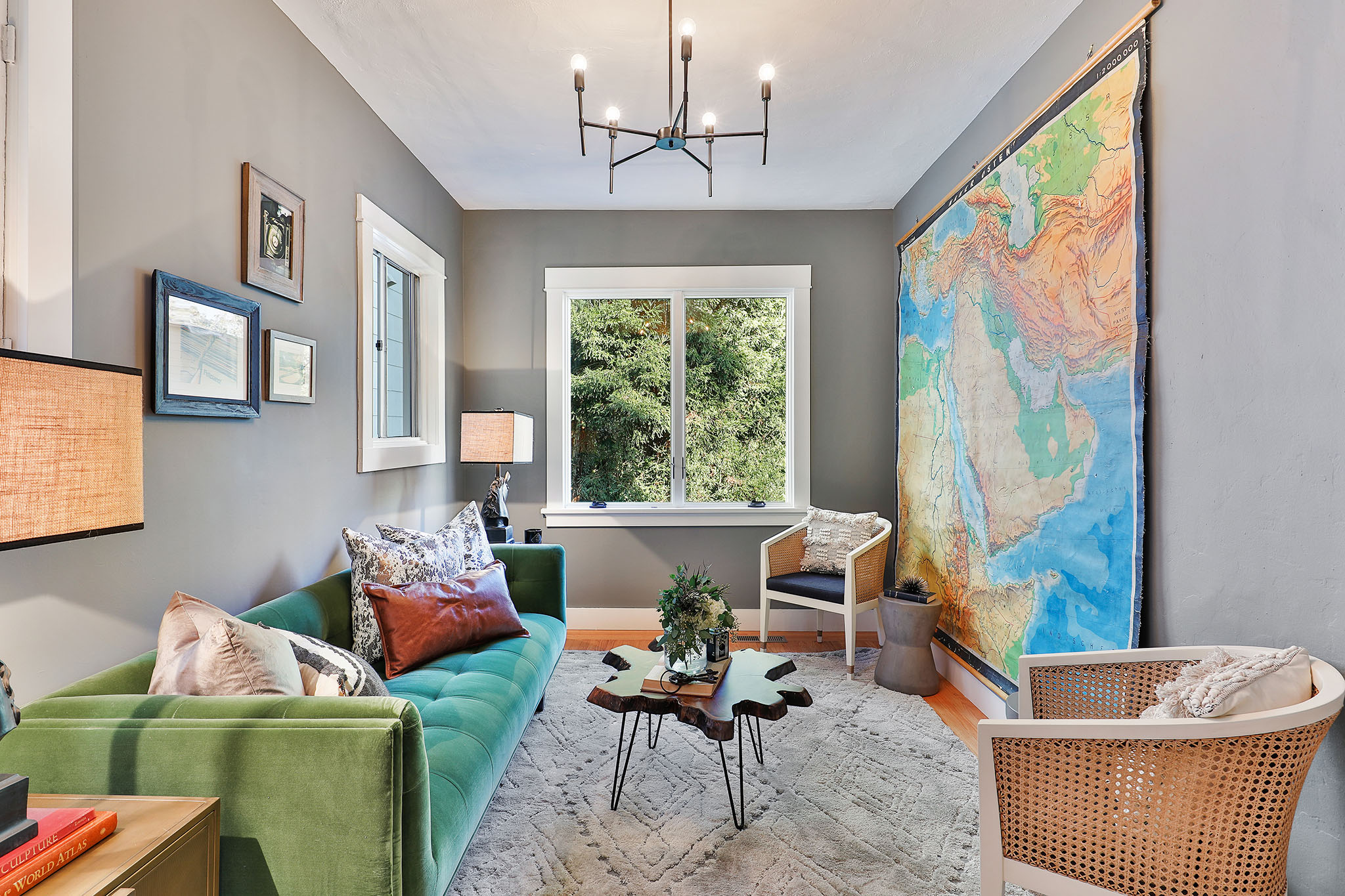 sf luxury home - living room with green velvet couch and wal lmap