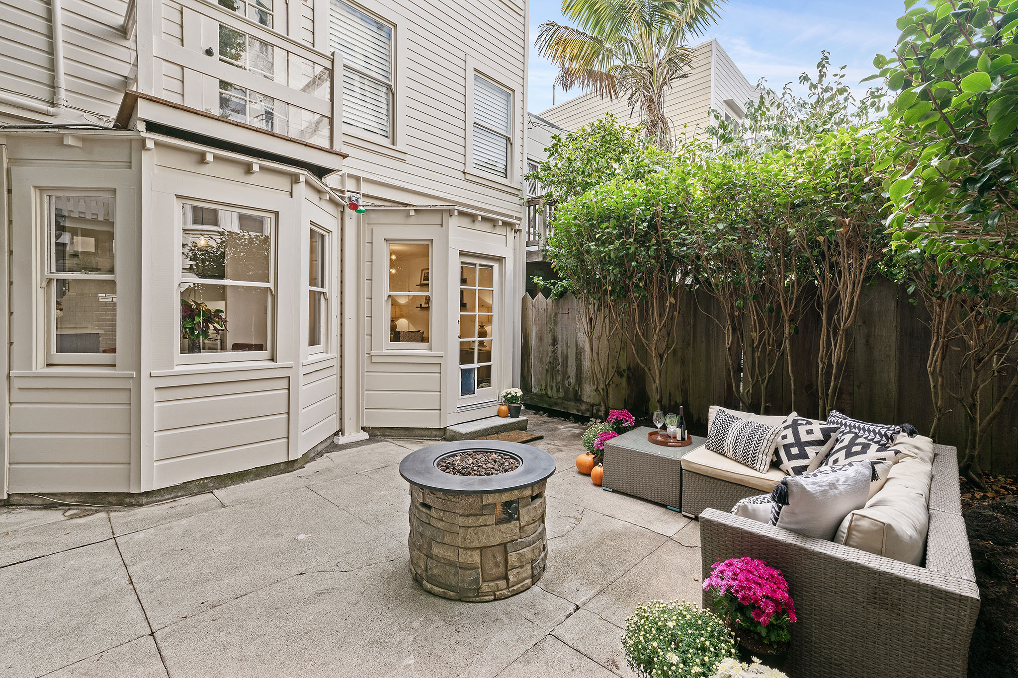 SF Home - patio with firepit and couch