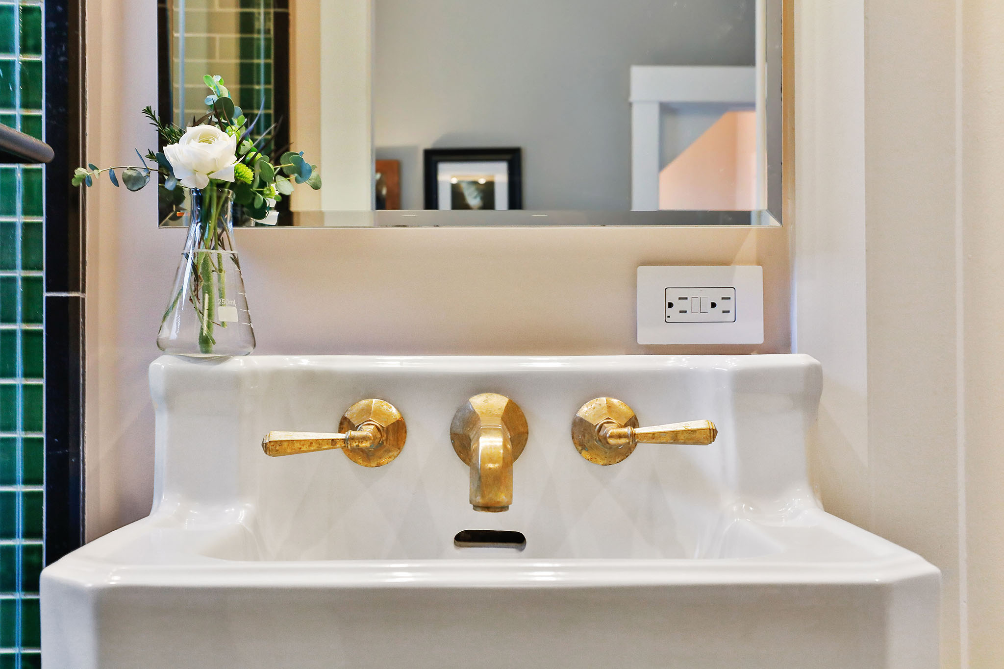 SF Real Estate - Bathroom sink with gold fixtures